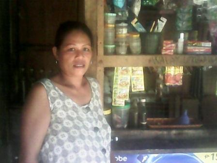 Ana's microloan story includes a $100 by Dr. Joe Johnson helping restock canned goods and other supplies on her shelves.